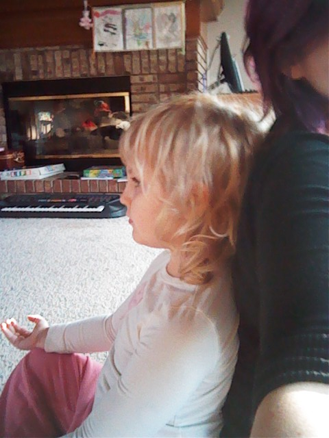Meditating briefly with the little one.